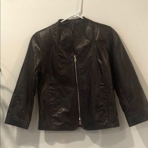 Brown zipper up leather jacket.